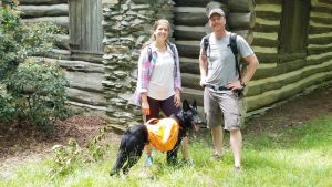 My wife Sarah and I on a hike up in PA. Loki carried his own food and water and had a blast!